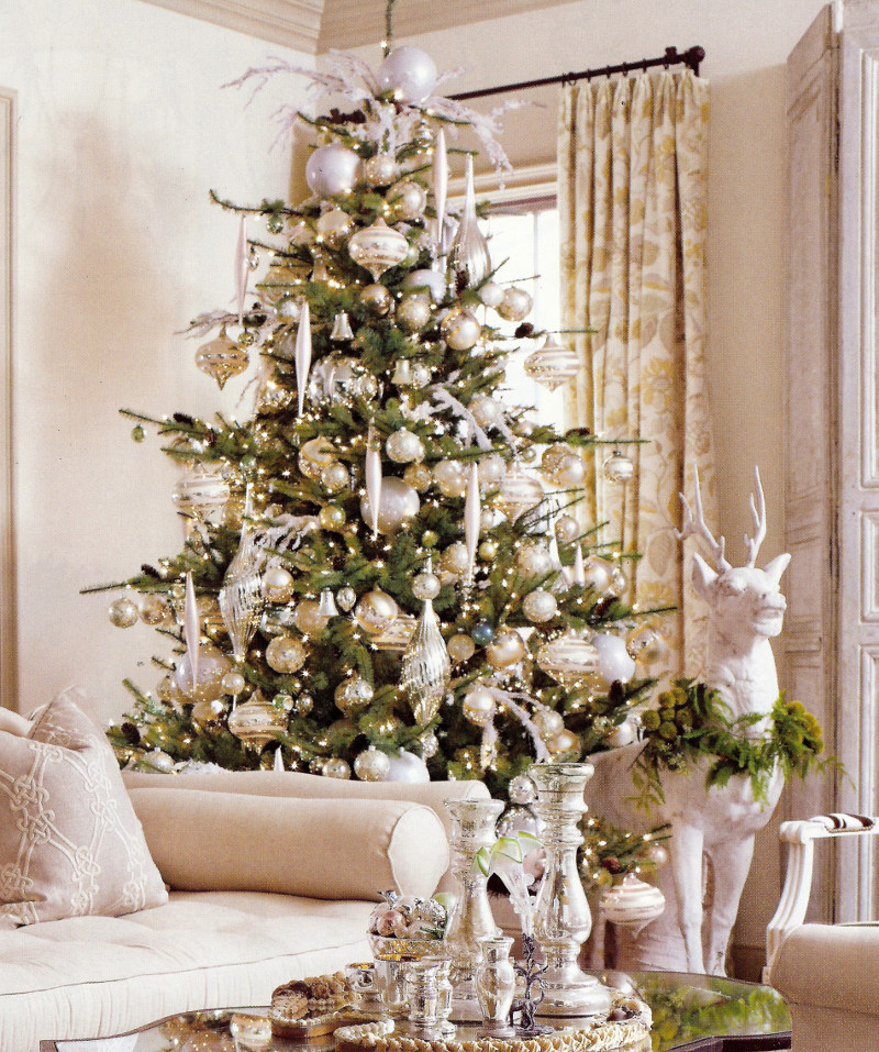 Christmas palette — silver and white Christmas tree with white standing stag sculpture nearby - Veranda via Atticmag
