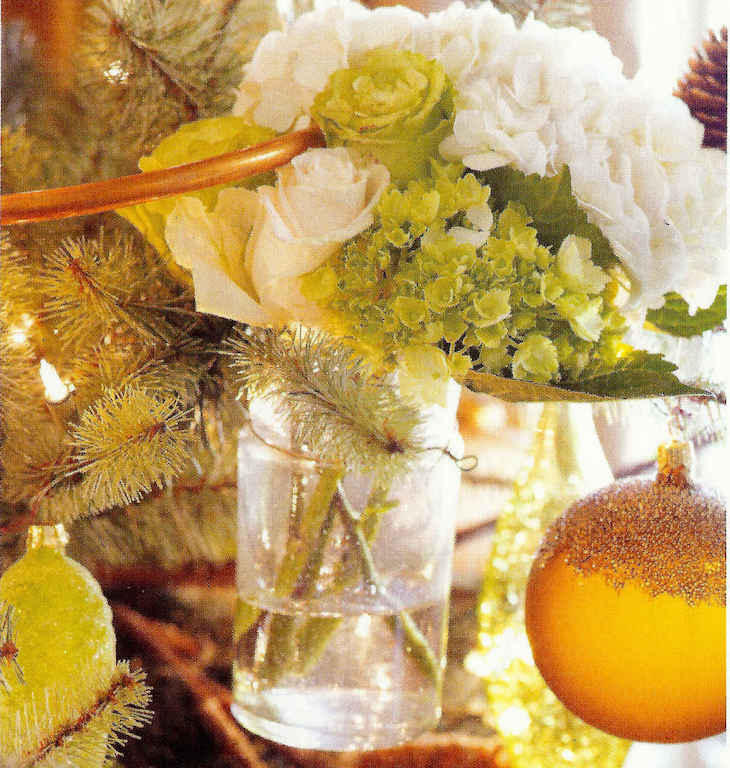 Christmas palette — small grape-drying vases filled with fresh flowers on a gold-tone Christmas tree - Veranda via Atticmag