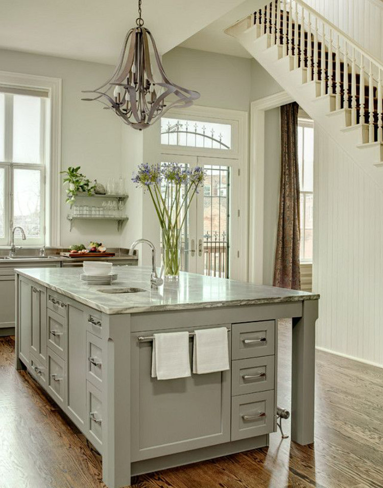 kitchen island storage - St. Louis old house renovated kitchen with drawers and towel rack on the end - mitchell wall via atticmag