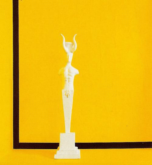 Oriel Harwood ceramic candlestick on the tub ledge in René Stoeltie's sunflower yellow bathroom - WOI via Atticmag