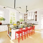 home décor trends - black and white Houston kitchen with tile walls and red accent by Miles Redd - AD via Atticmag