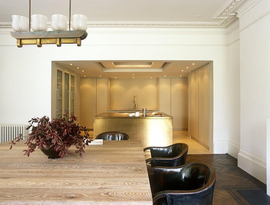 home décor trends - John Minshaw's minimalistic kitchen with a gold tone island - John Minshaw via Atticmag