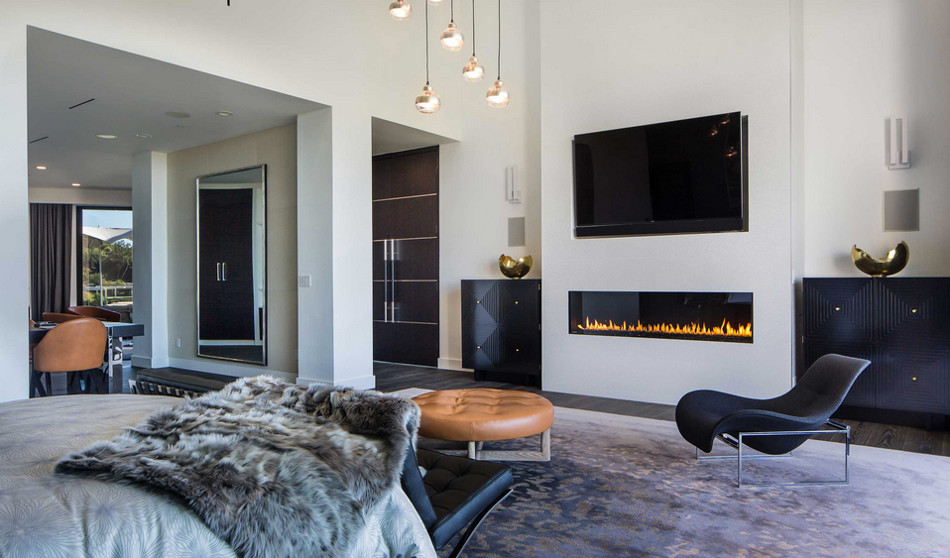 modern mansion - linear gas fireplace with flat screen TV above it Beverly Hills home designed by Kirk Nix purchased by Chrissy Teigen & John Legend - KNA Design via Atticmag