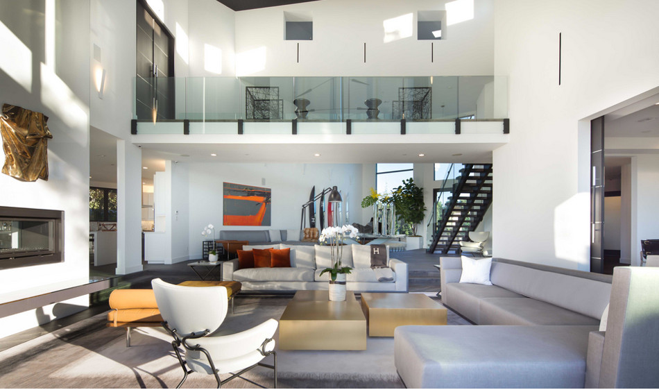 modern mansion - living room of two-story Beverly Hills home designed by Kirk Nix purchased by Chrissy Teigen & John Legend - KNA Design via Atticmag