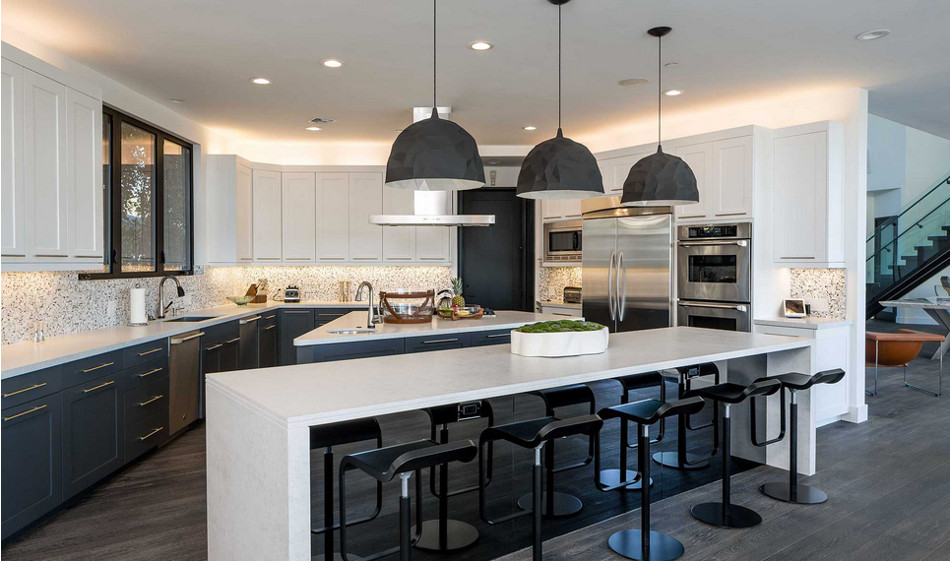 modern mansion - black and white kitchen of Beverly Hills home designed by Kirk Nix purchased by Chrissy Teigen & John Legend - KNA Design via Atticmag
