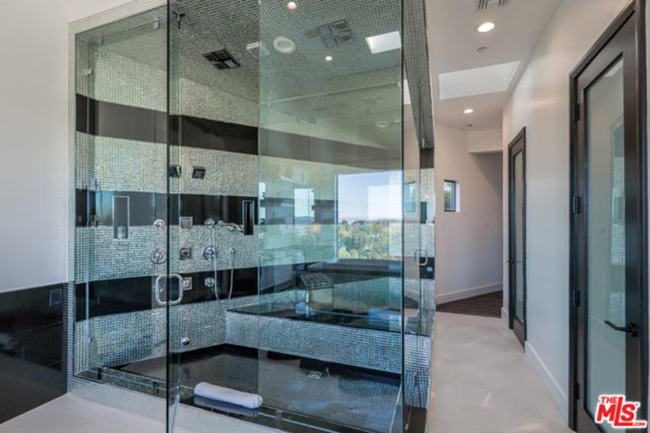 modern mansion - black and silver tiled steam shower in Beverly Hills home designed by Kirk Nix purchased by Chrissy Teigen & John Legend - MLS via Atticmag