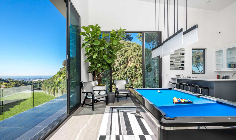 modern mansion - billiard room of Beverly Hills home designed by Kirk Nix purchased by Chrissy Teigen & John Legend - KNA Design via Atticmag