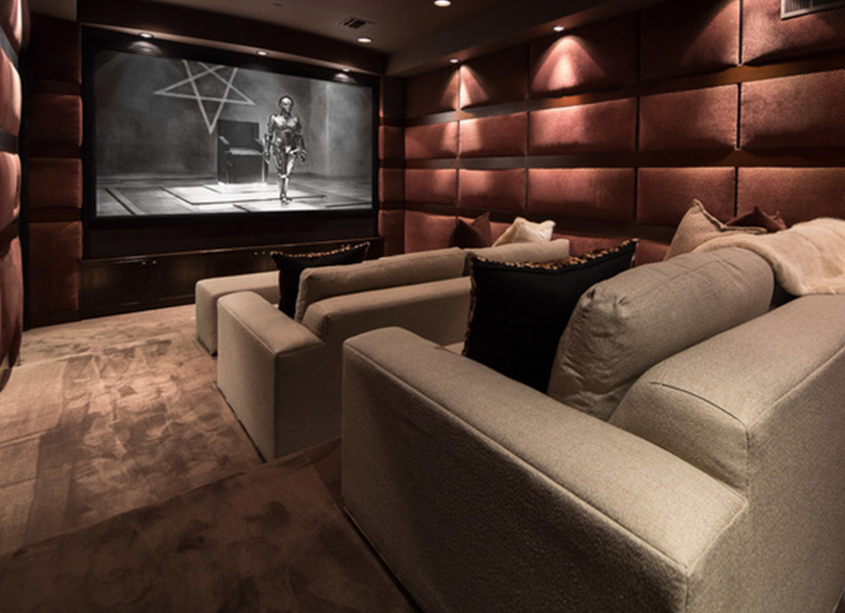 modern mansion - brown and marsala colored screening room of Beverly Hills home designed by Kirk Nix purchased by Chrissy Teigen & John Legend - MLS via Atticmag