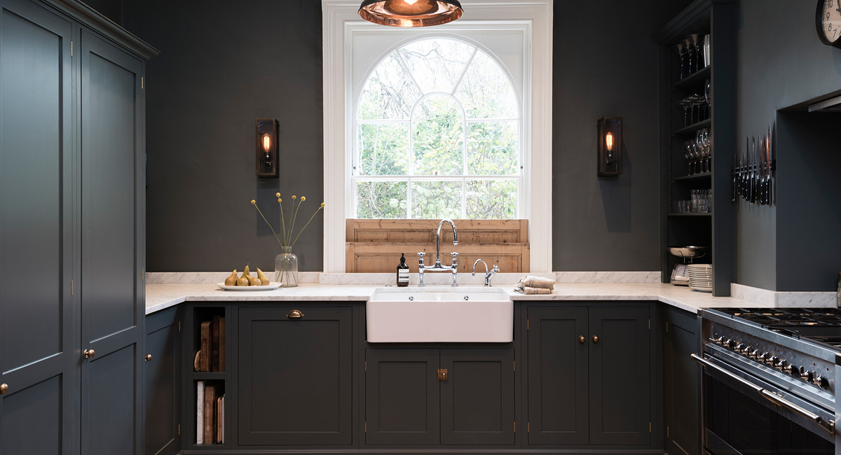 dark gray kitchens - deVol kitchen in Flint with natural wood bottom-mount indoor shutters - deVol Kitchens via Atticmag