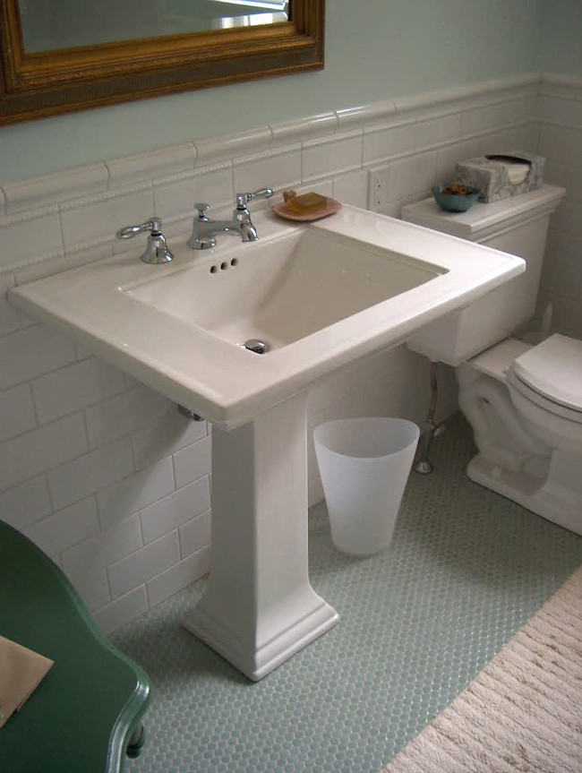 seafoam guest bath - Memoirs Stately pedestal sink and Ann Sacks green penny round floor tiles - Atticmag