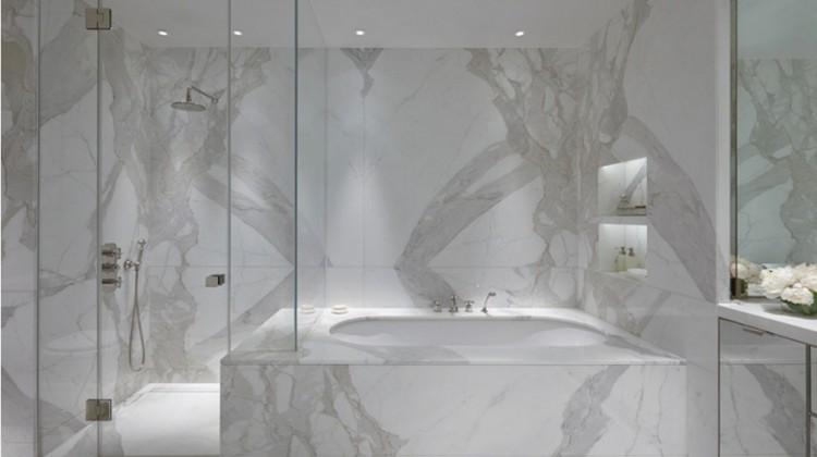 white marble bathroom - tub and shower wall of statuario veneto minimalist bath - Todhunter Earle Interiors via Atticmag