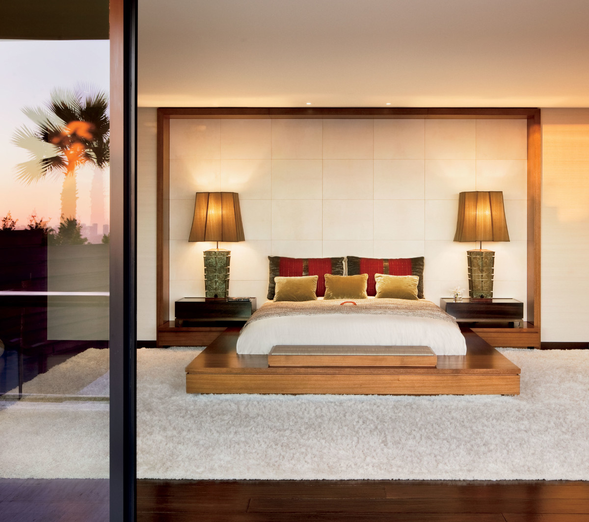 hidden tvs - motorized flip up tv concealed in the base of a platform bed in an Asian inspired Beverly Hills bedroom by Stephen Shadley - AD via Atticmag