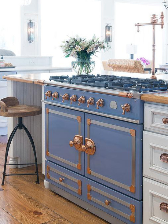 blue La Cornue - CornuFé 110 in Provence blue in a white kitchen - Karr Brick via Atticmag