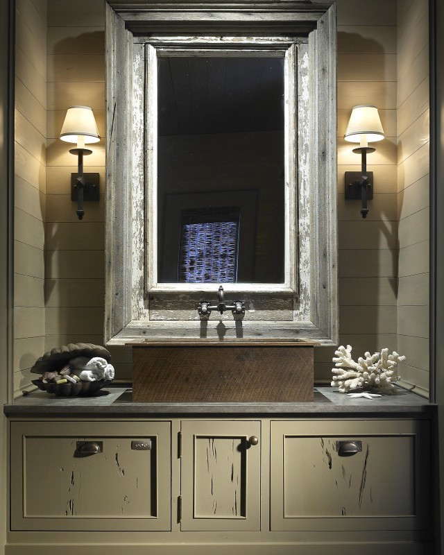 modern powder room sinks - khaki colored powder room with metal basin sink mounted on the vanity - Tracy HIckman Interiors via Atticmag