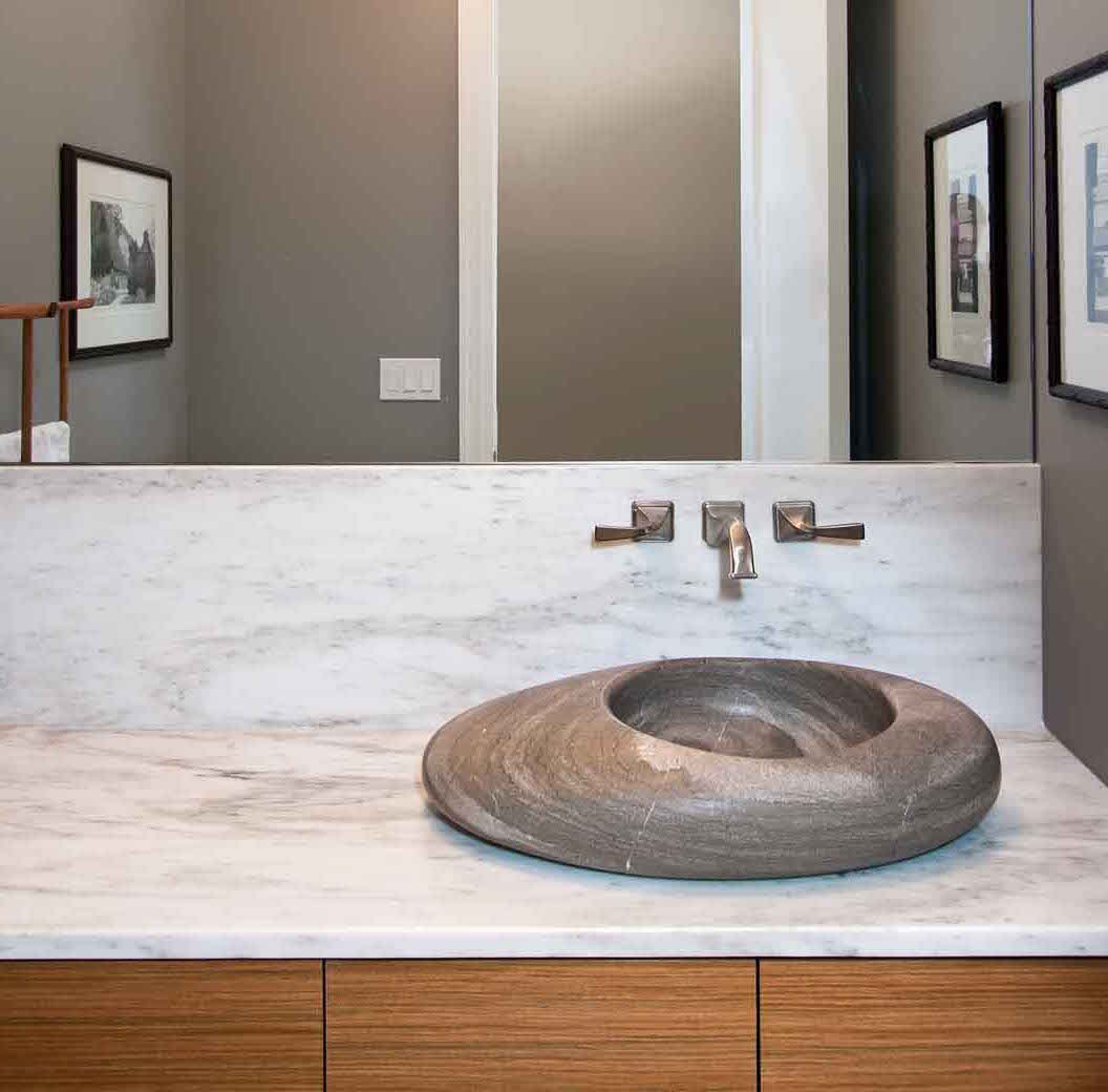 modern powder room sink - sculptural stone bowl sink on a marble vanity top - amy may designs via Atticmag