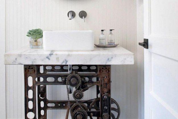 vessel sinks - square vessel sink on a Carrara marble slab makes a distinctive vanity with an industrial steampunk base - Antonio Martins via Atticmag