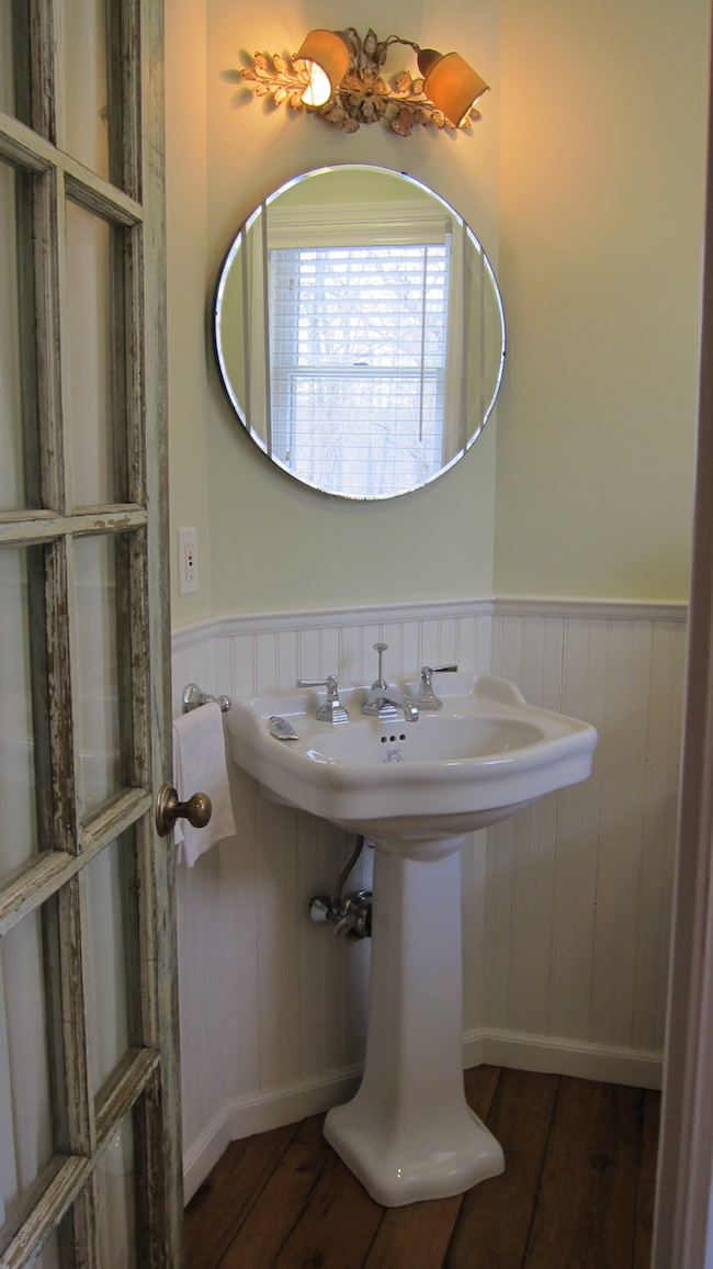 powder room - existing 25 square foot powder room with Lefroy Brooks sink, Kallista faucet, 1947 mirror and antique sconce - Atticmag