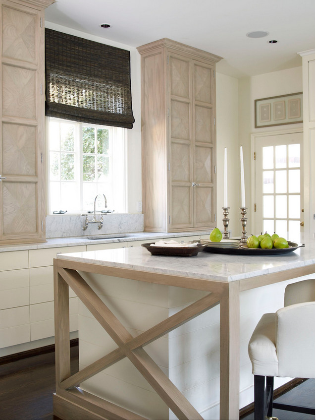 pale neutral kitchens - Cream, light wood and white kitchen with a Hollywood Regency cabinet twist and cross buck island - Andrew Brown Interiors via Atticmag