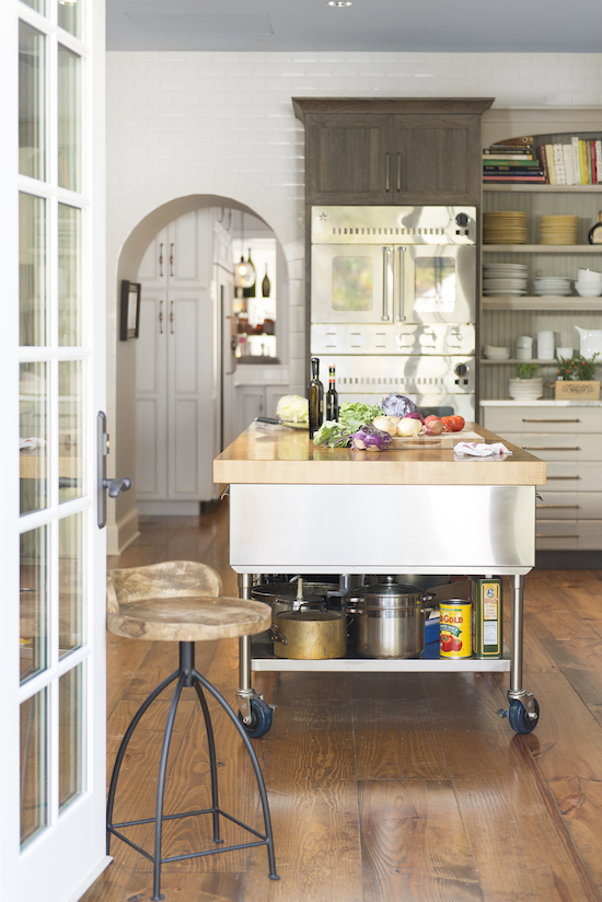 """two kitchens - view of the second """"dirty"""" kitchen designed by Jenny Rausch featuring a custom island and double Blue Star french door ovens - Karr Bick via Atticmag"""