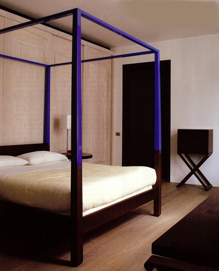 four poster beds - Furniture designer Christian Liagre added blue lacquer to the top of each bed post and the canopy for a client in Spain who admires Yves Klein - WOI via Atticmag