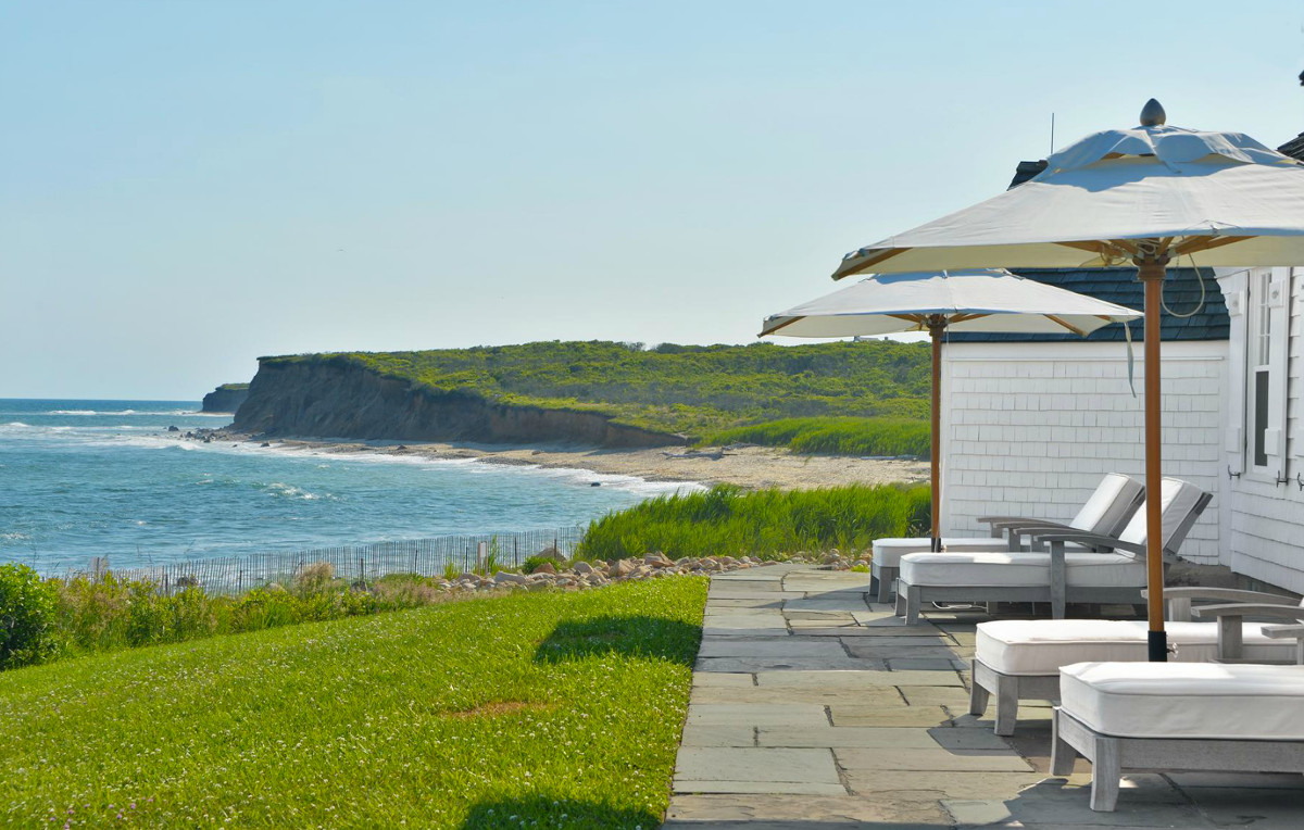 Andy Warhol beach house - view of the Atlantic Ocean and the Eothen private beach from a cottage terrace on the Montauk cliff - Gotham Photo Company via Atticmag