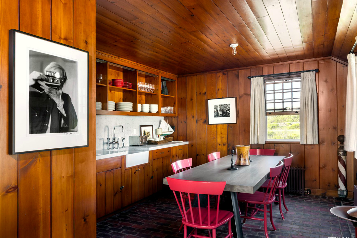 Andy Warhol beach house - original pine paneling preserved in the renovated kitchen of a cottage at Eothen in Montauk - Gotham Photo Company via Atticmag