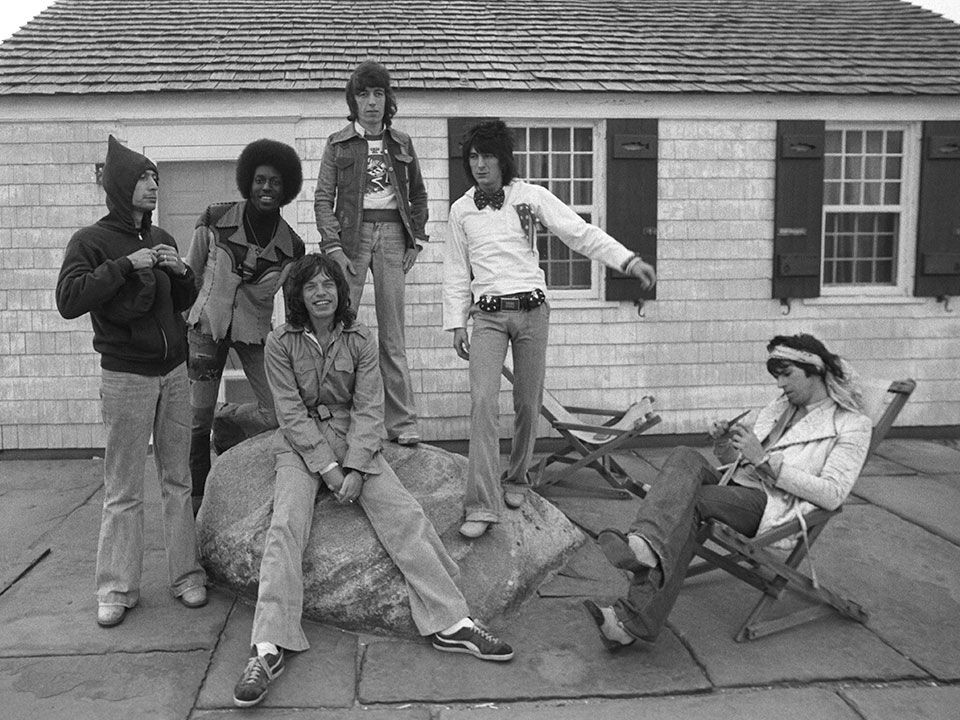 Andy Warhol beach house - The Rolling Stones on the Eothen patio when they rented the estate from Any Warhol in 1975 - tumblr via Atticmag
