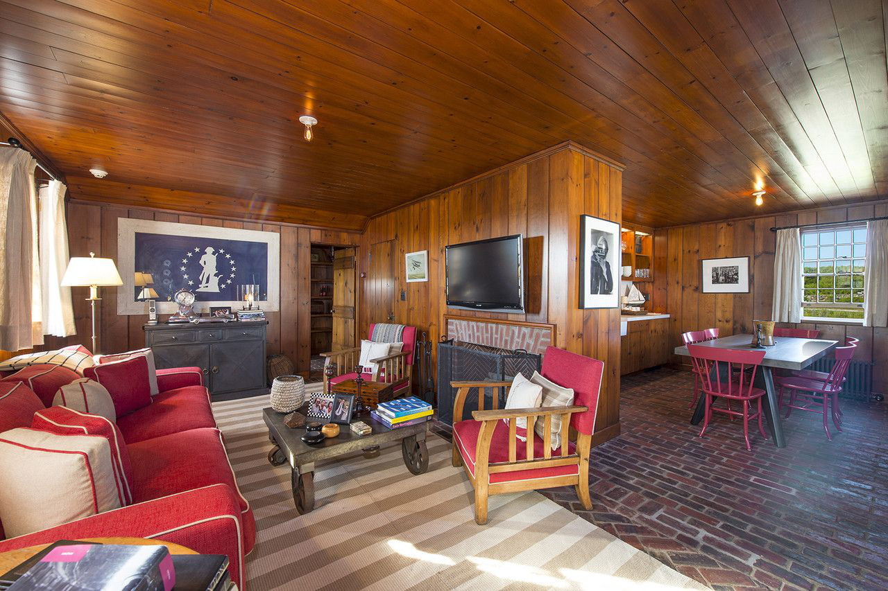 Andy Warhol beach house - pine paneled sitting room and renovated kitchen of a cottage at Eothen in Montauk, Long Island - Gotham Photo Company via Atticmag