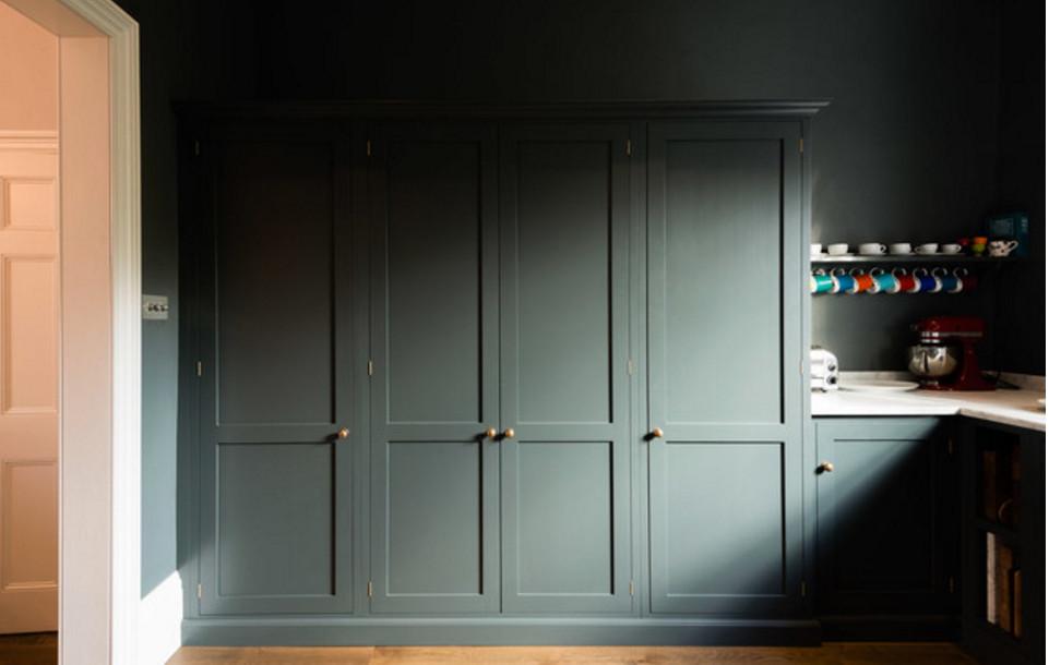 deVol kitchen - Exterior view of a larder cabinet in a deVol kitchen with Shaker cabinets in Flint gray - deVol Kitchens via Atticmag