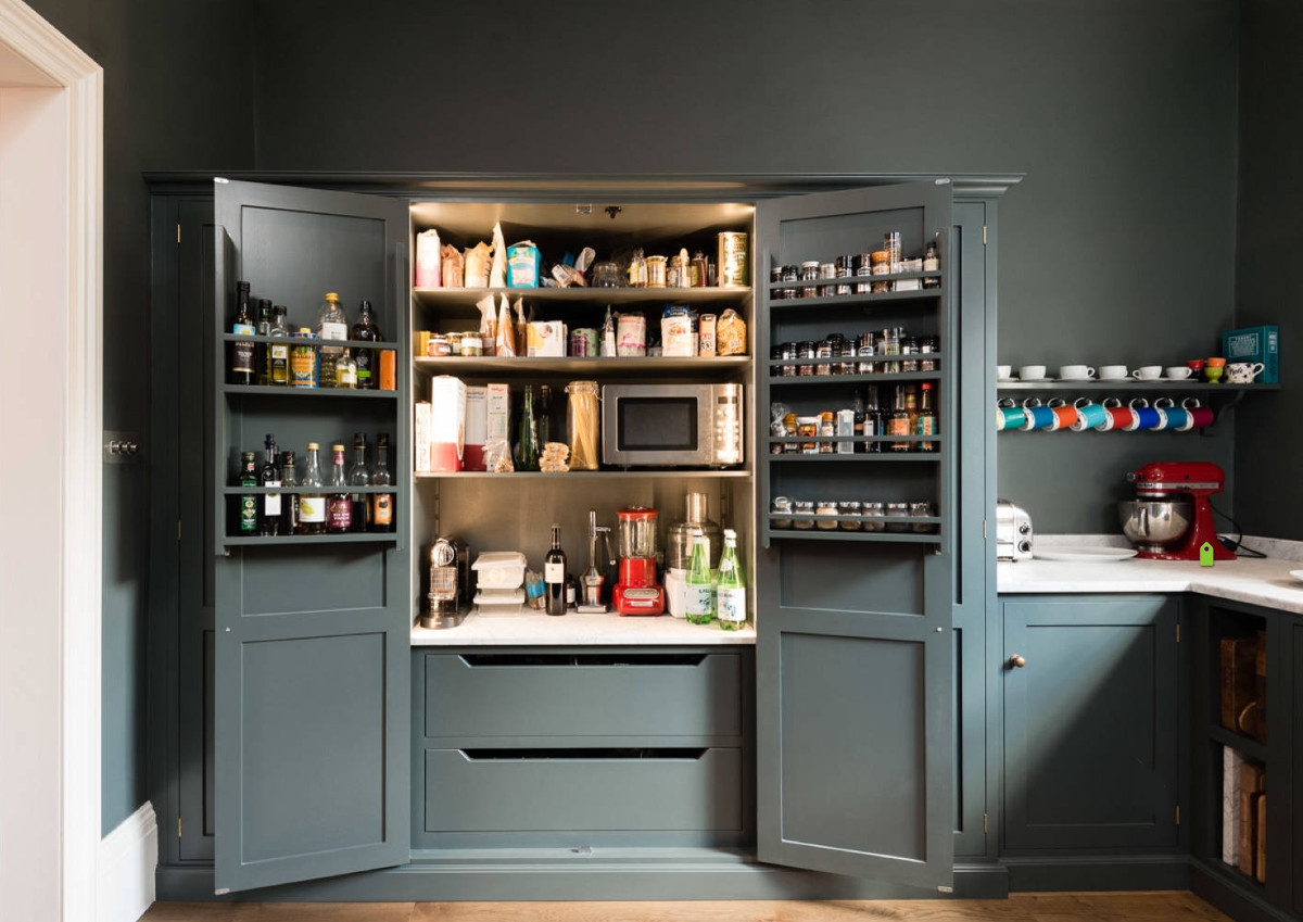 deVol kitchen - Interior view of lighted larder cabinet in a deVol kitchen with Shaker cabinets in Flint gray - deVol Kitchens via Atticmag