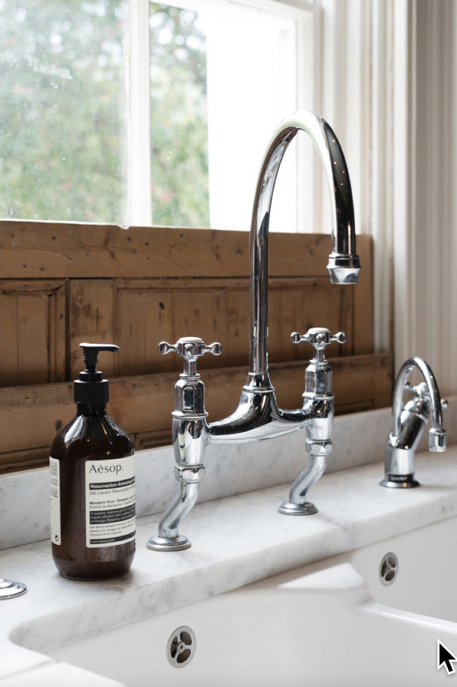 deVol kitchen - Bridge faucet with offset legs and a Quooker instant boiling water faucet on the sink of a deVol kitchen with Shaker cabinets in Flint gray - deVol Kitchens via Atticmag