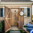 rustic outdoor shower - with detachable hand spray and foot-washing spigot behind the hgtv 2015 Martha's Vineyard dream home - hgtv via atticmag