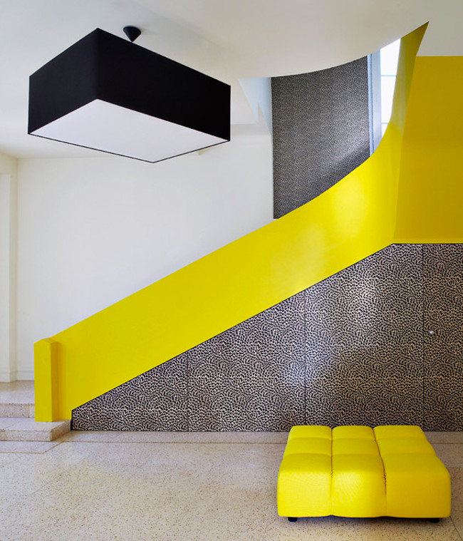 modern staircases - yellow and print paneled staircase in a Cannes villa renovated by Studio Maclean - ad.ru via Atticmag