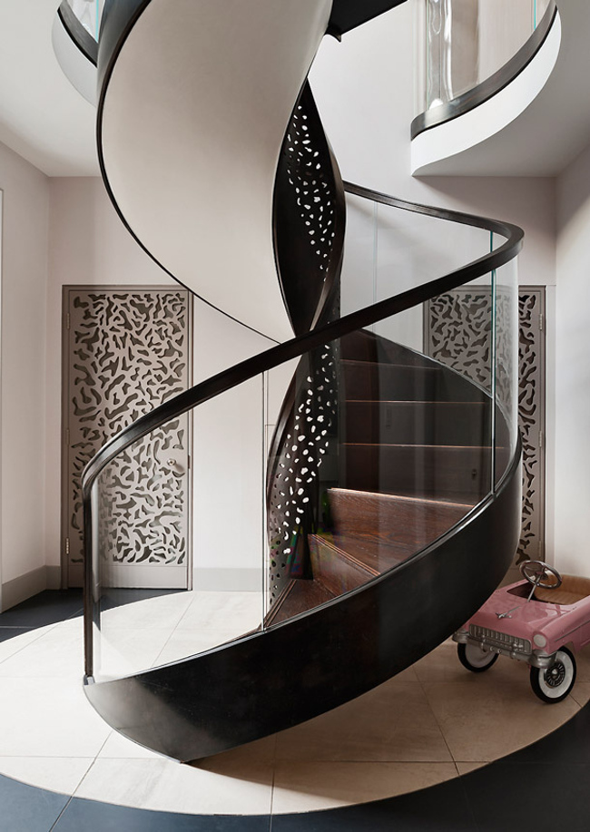 modern staircase - freestanding pierced bronze and glass staircase by Make Architects for a London house - ad.ru via Atticmag