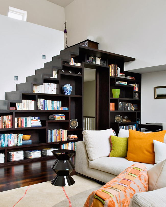 modern staircase - dark wood loft staircase in London built over a bookcase by Project Orange Architects - ad.ru via Atticmag