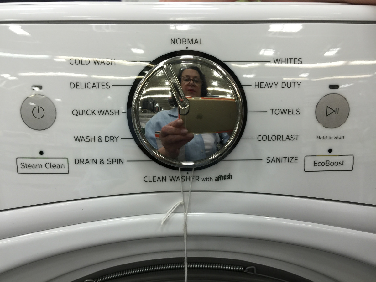 front load washing machine - control panel showing cycles and the essential steam setting - Atticmag.com