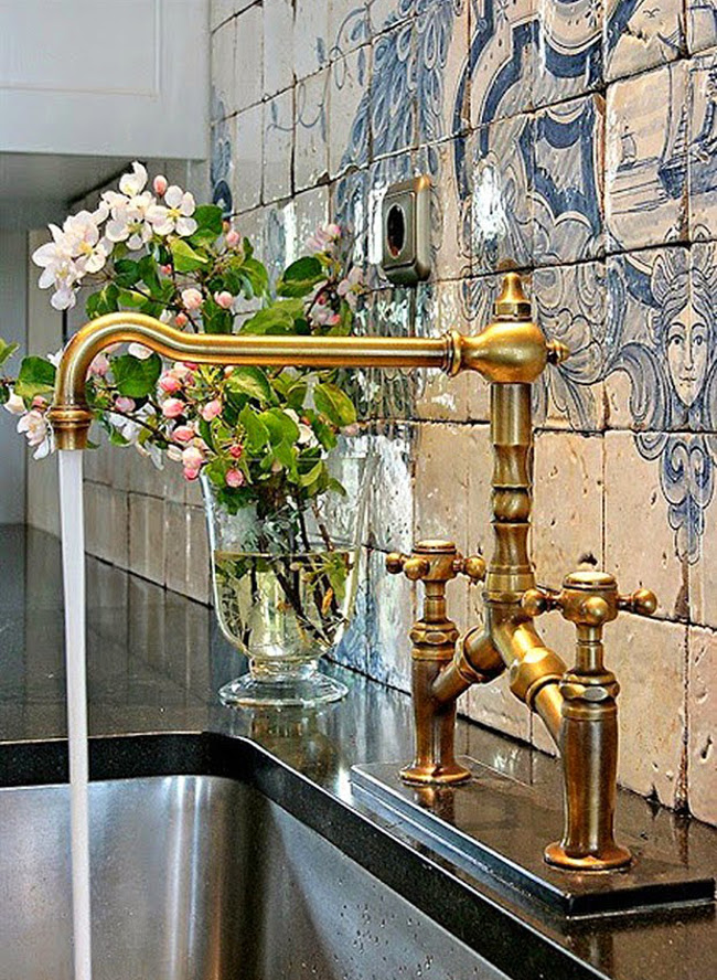 blue and white antique Portuguese tile backsplash with a cartouche, sailing ship and floral elements - The Essence of the Good Life/Apartment Therapy via Atticmag