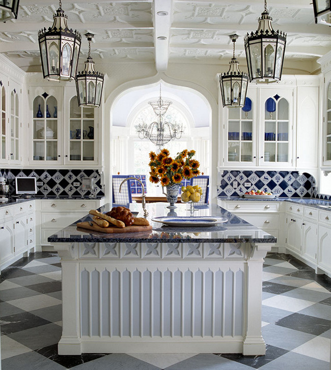 blue and white tile backsplash with figural and solid blue and white tiles in an Anthony Baratta Gothic revival kitchen - Anthony Baratta via Atticmag