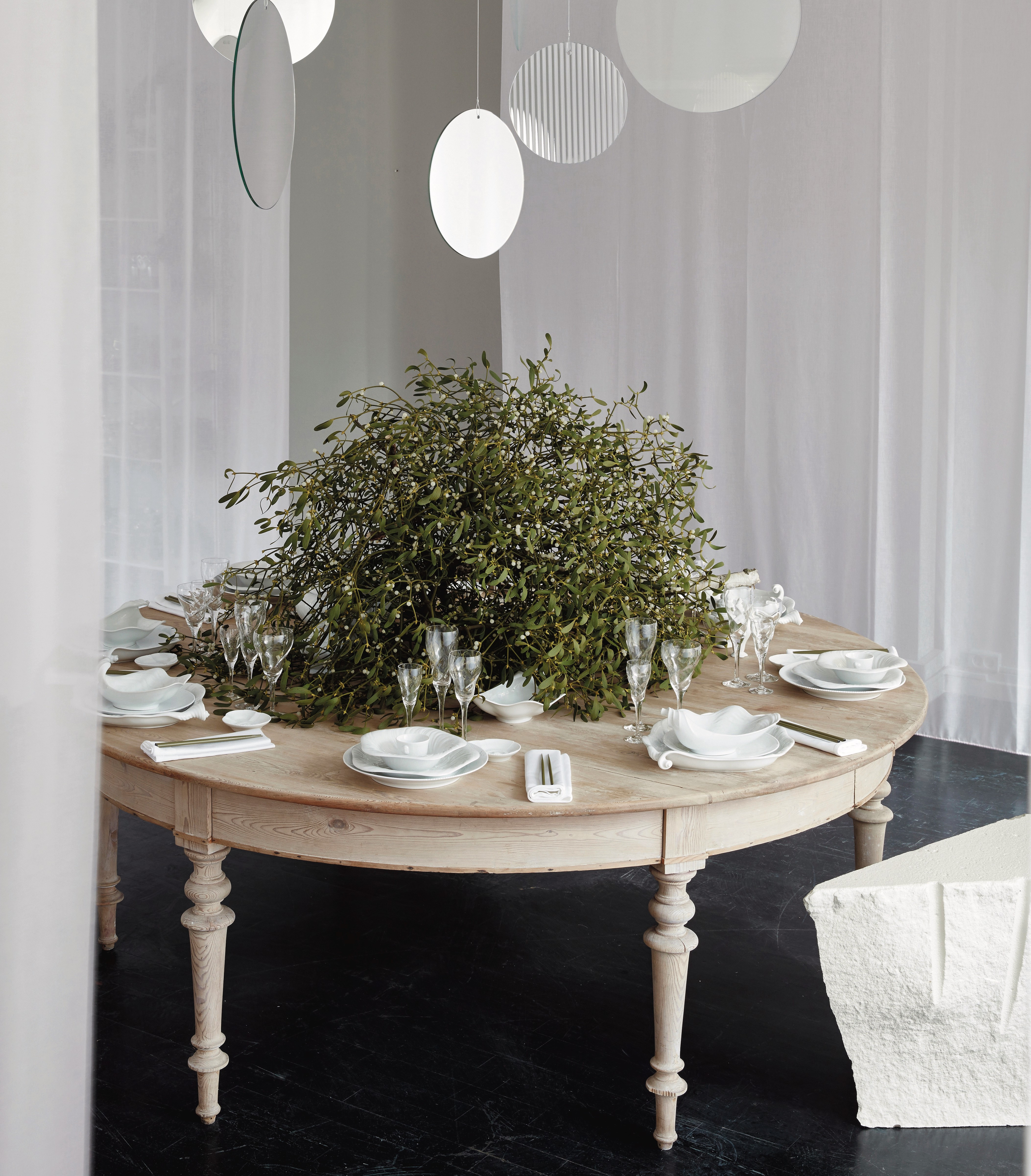 fashionable Christmas - Mark Tan's traditional Scandinavia table with natural greenery takes on a dramatic organic white-on-white affect with RC White Fluted porcelain plus Arje Griegst's Conch series dishware - Royal Copenhagen via Atticmag