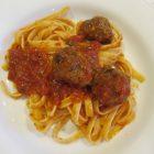 homemade black Angus meatballs with tomato sauce over fettuccine - Atticmag