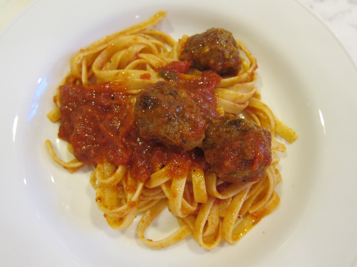 homemade black Angus meatballs with tomato sauce over fettuccine - Atticmag