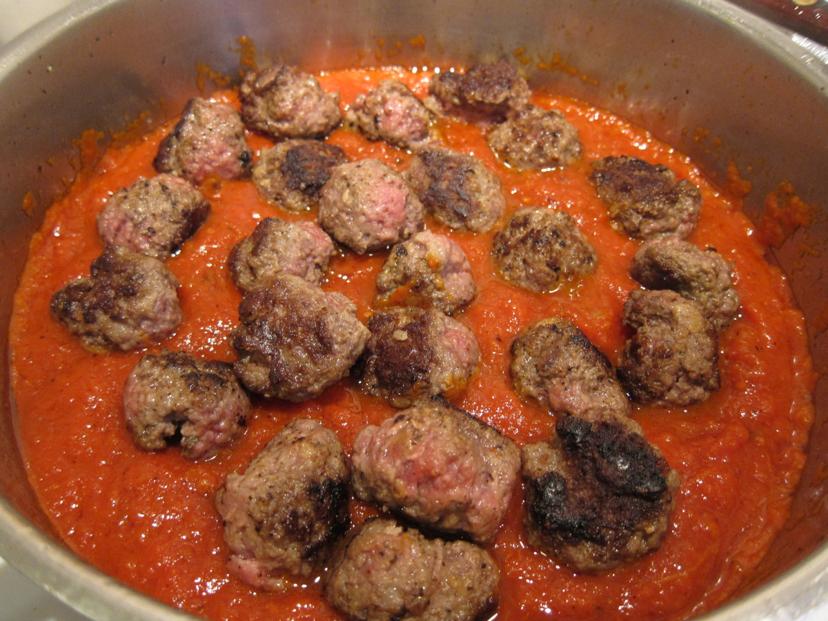 browned black Angus meatballs are added to the pasta sauce and simmered for a few minutes to finish cooking - Atticmag