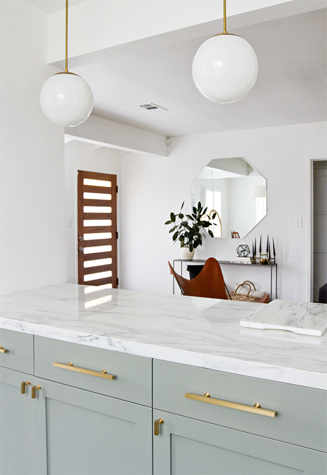 pale green kitchens - Farrow & Ball's Pigeon on base cabinets in a renovated kitchen with brass hardware - Sarah Sherman Samuel via Atticmag