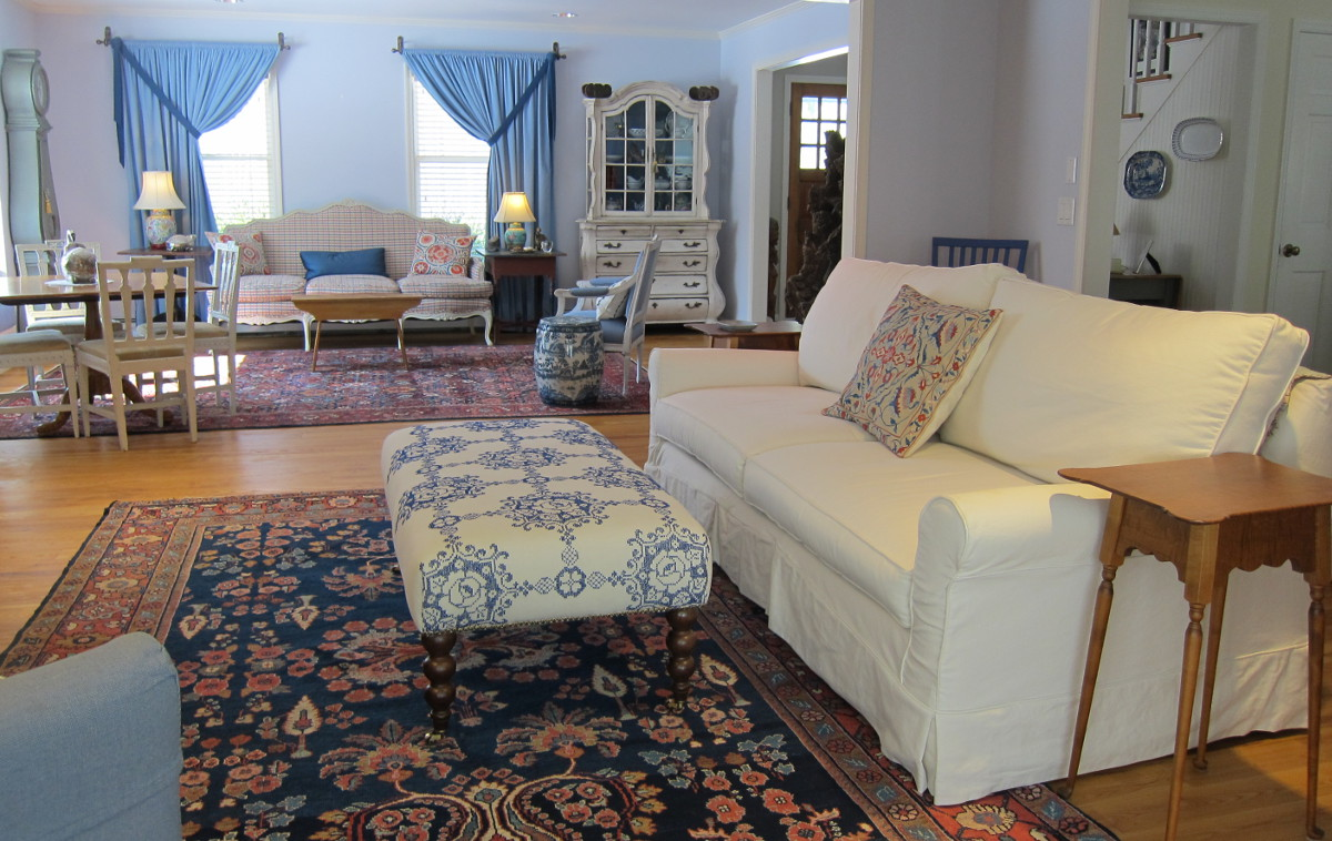 ottoman reupholstered with an embroidered vintage tablecloth in my TV room - Atticmag