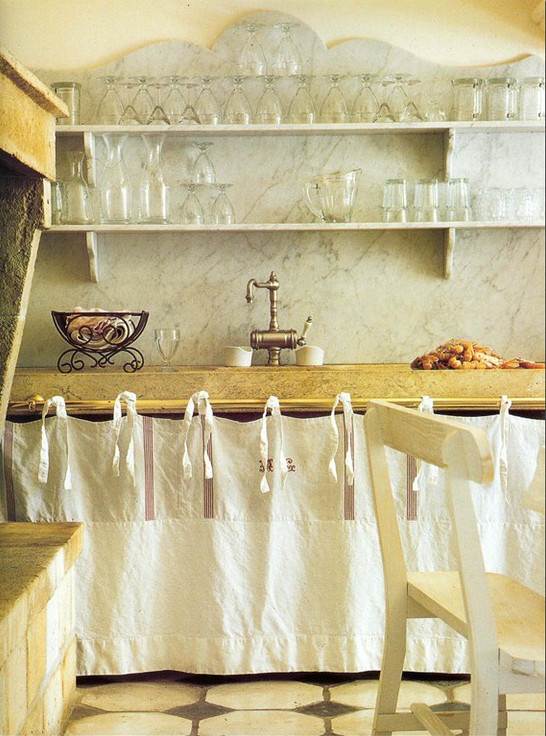 kitchen character can be created by skirting base cabinets or counters with vintage French textiles - Vintage Rose Garden via Atticmag