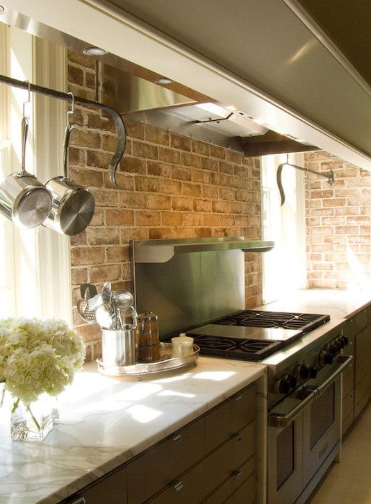 kitchen character can be created by using architectural elements like existing brick walls - Decorpad via Atticmag