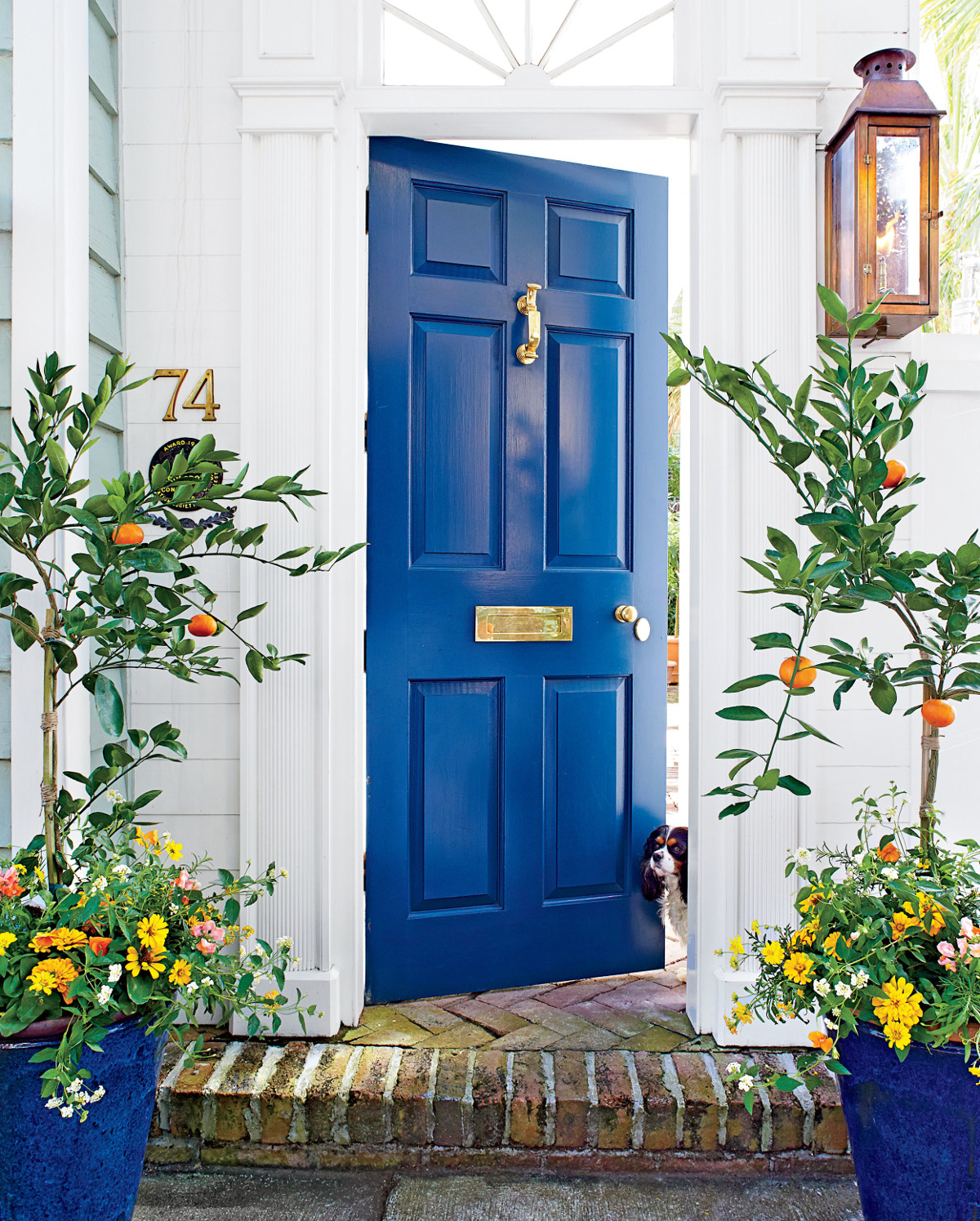 cobalt blue front door - Southern Living via Atticmag