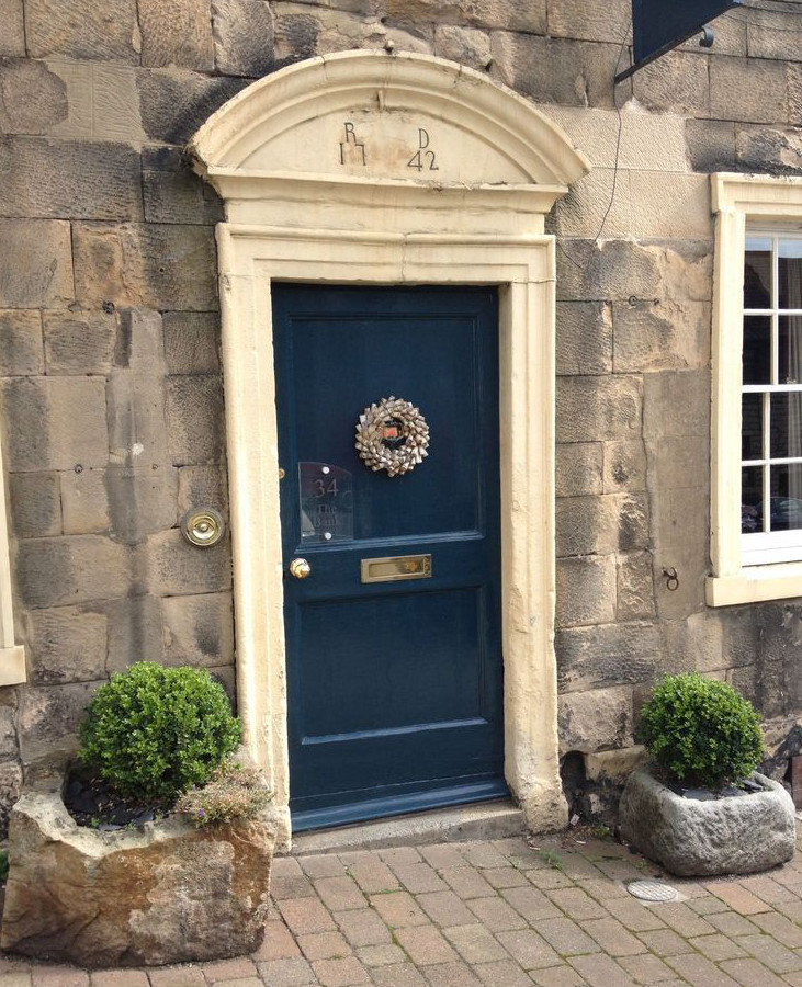 front door painted with Farrow and Ball Hague Blue - Farrow and Ball via Atticmag