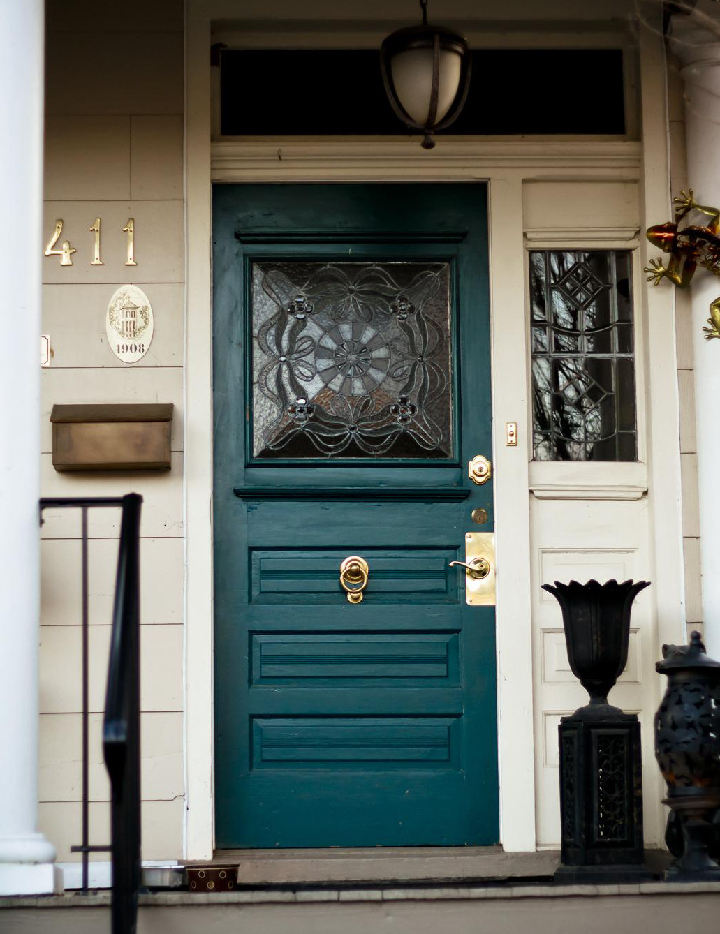teal front door - pinterest via Atticmag
