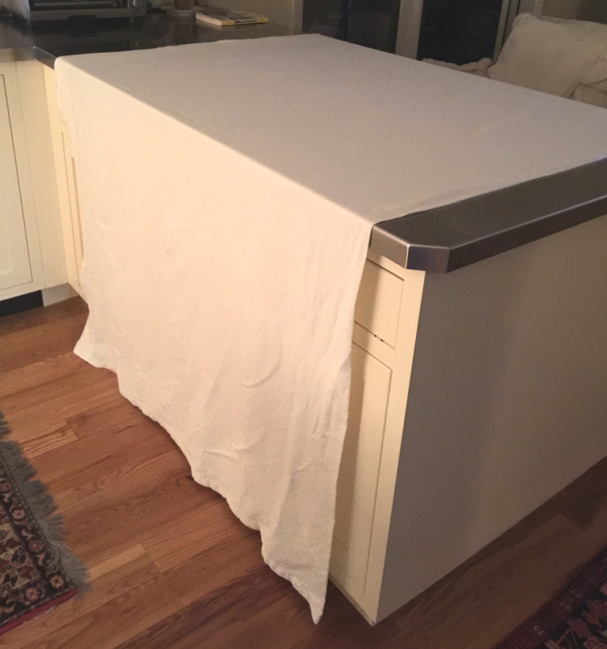 linen bed sheets - air drying a king size linen bed sheet over the kitchen counter - Atticmag